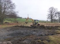 Digger clearing tennis court - 01022014